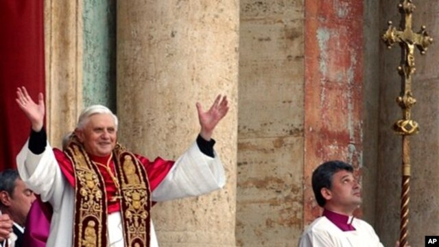 Pope Benedict the 16th waves to the crowd from the central balcony of St. Peter's Basilica after being newly elected, the Vatican, April 19, 2005.