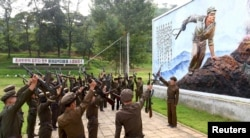 North Koreans sign up to join the army in the midst of political tension with South Korea, in this undated photo released by North Korea's Korean Central News Agency (KCNA) in Pyongyang August 23, 2015.