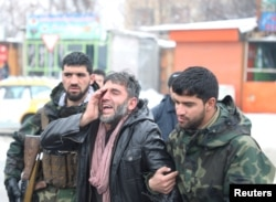 An Afghan man reacts near the site of a suicide attack in Kabul, Afghanistan February 11, 2020.