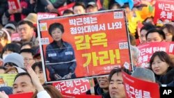 Protesters rally calling for impeached President Park Geun-hye's arrest in Seoul, South Korea, March 11, 2017.