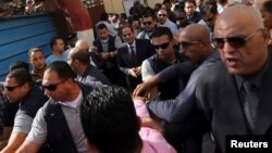 Presidential candidate and former army chief Abdel Fattah el-Sissi arrives with his bodyguards at a polling station in Cairo, May 26, 2014.