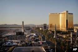 The Mandalay Bay resort and casino, right, overlooks an outdoor festival grounds across the street, left, Tuesday, Oct. 3, 2017, in Las Vegas. Authorities said Stephen Craig Paddock broke the windows on the casino and began firing with a cache of weapons,