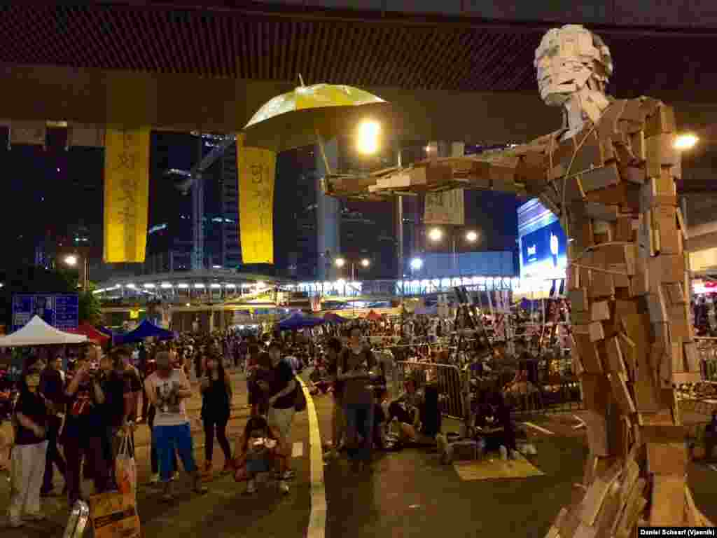 "A wood art sculpture titled ""Umbrella Man"" sits amidst the Hong Kong Occupy Central protest area, Oct. 5, 2014."