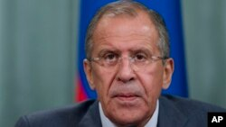 Russian Foreign Minister Sergey Lavrov speaks during a news conference after his meeting with French counterpart Laurent Fabius, unseen, in Moscow, Russia, Sept. 17, 2013.