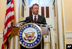 FILE - Sen. Rand Paul, R-Ky., Answers questions from reporters during a press conference on Capitol Hill in Washington.