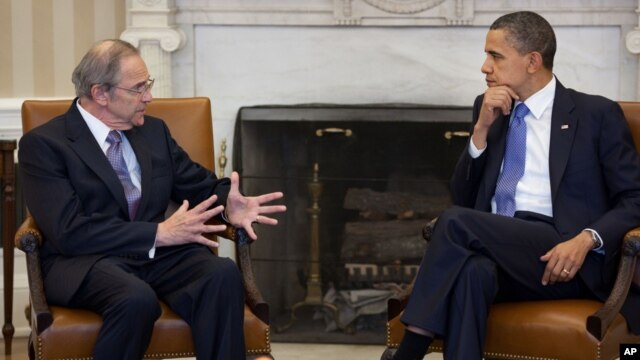 President Barack Obama meets with Sudan Special Envoy Ambassador Princeton Lyman in the Oval Office, April 1, 2011.