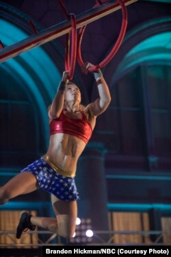 Dressed as Wonder Woman, Jessie Graff finishes the Los Angeles qualifying event for American Ninja Warrior.