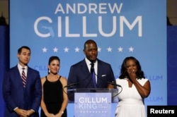 FILE - Democratic Florida gubernatorial nominee and Tallahassee Mayor Andrew Gillum concedes the race to U.S. Rep. Ron DeSantis as Gillum's running mate Chris King, left, King's wife Kristin, center, and Gillum's wife R. Jai watch at his side during his midterm election night rally in Tallahassee, Florida, Nov. 6, 2018.