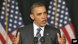 President Barack Obama outlines his fiscal policy during an address at George Washington University in Washington, April 13, 2011