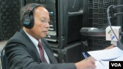 FILE - Government spokesman Phay Siphan sits in the VOA studio in Phnom Penh in 2012.