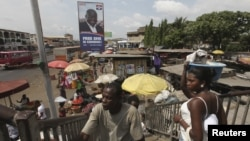 A poster of the opposition New Patriotic Party (NPP) presidential candidate Nana Addo Danquah Akufo Addo is pictured on a street in Accra, December 2, 2012.