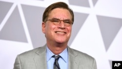 """FILE - Aaron Sorkin arrives at the 90th Academy Awards Nominees Luncheon in Beverly Hills, Calif., Feb. 5, 2018. The estate of """"To Kill a Mockingbird"""" author Harper Lee has filed suit over an upcoming Broadway adaptation of the novel set to open in December."""