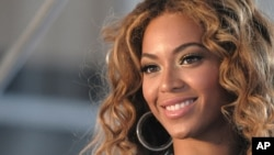 Beyoncé poses for pictures at a press conference June 22, 2009 in New York.