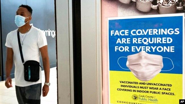ریاست الی نائے میں ایک سٹور میں کرونا سے متعلق احتیاطی تدابیر پر مبنی پوسٹر لگا ہے۔