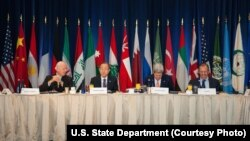 From left, U.N. Special Envoy for Syria Staffan de Mistura, U.N. Secretary-General Ban Ki-moon, U.S. Secretary of State John Kerry and Russian Foreign Minister Sergei Lavrov lead a meeting on a plan for establishing a transitional government in Syria, in