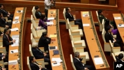 FILE - Deputies are seen at Parliament House in Hanoi, Vietnam, Nov. 6, 2015. The country's legislature on Tuesday endorsed the government's decision to scrap plans to build Vietnam's first two nuclear power plants.