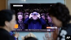 FILE - A TV news program shows a file image of North Korean leader Kim Jong Un at the Seoul Railway Station in Seoul, South Korea, May 14, 2017.