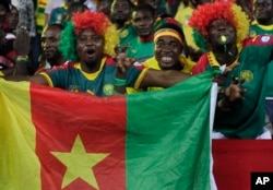 FILE - Cameroon's supporters chant ahead of the African Cup of Nations Group A soccer match between Cameroon and Gabon at the Stade de l'Amitie, in Libreville, Gabon, Jan. 22, 2017.