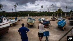 Fishermen inspect their boats after they have been taken out of the bay to avoid damage from the passage of Tropical Storm Elsa, in Havana, Cuba, July 5, 2021.