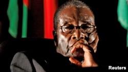 Owayengumongameli uMnu. Robert Mugabe.