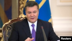 FILE -Ukraine's President Viktor Yanukovych takes part in a news conference in Kyiv, December 19, 2013.