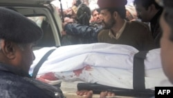 The body of assassinated Pakistan's minority minister is carried from a hospital after he was killed in Islamabad, March 2, 2011