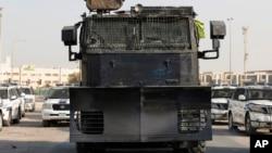FILE - Police vehicles block the road to al-Ekr village, Bahrain, July 19, 2015.