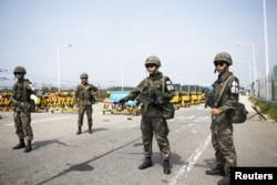 South Korean soldiers stand guard at checkpoint on Grand Unification Bridge which leads to truce village Panmunjom, just south of the demilitarized zone separating the two Koreas, in Paju, South Korea, Aug. 24, 2015.