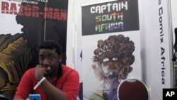 "Bill Masuku, a Zimbabwean comic book artist and writer, sits at a stall at Comic Con Africa, a three-day comic book and pop culture convention in Johannesburg, South Africa, Sept. 15, 2018. The success of Marvel's ""Black Panther"" film spiked interest in African stories, and creators on the continent hope to capitalize with more comic book characters of their own. The three-day convention ending Sunday in South Africa was a platform for their efforts, even if it was dominated by the global superheroes, villains and other pop culture figures who have been around for decades."