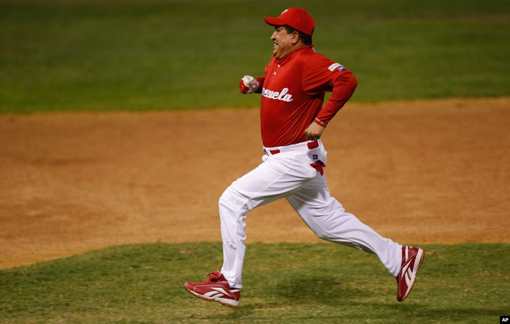 Chavez runs the bases after hiting a double during an exhibition softball game in Caracas, February 11, 2010.