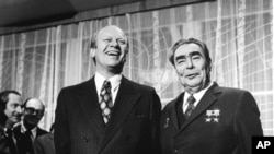 U.S. President Gerald Ford and Soviet Communist Party chief and the state leader Leonid Brezhnev share a joke just before their summit meeting in Vladivostok in this Nov. 24, 1974 file photo. (AP Photo/File)