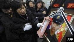 Похороны одного из морских пехотинцев, погибших в результате обстрела южнокорейского острова Енпхендо.