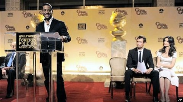 Actor Blair Underwood, left, announces nominations for the 68th Annual Golden Globe Awards as fellow presenters Josh Duhamel, second from right, and Katie Holmes look on in Beverly Hills, California, USA, 14 Dec 2010
