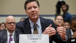 FBI Director James Comey testifies on Capitol Hill in Washington, July 7, 2016, before the House Oversight Committee to explain his agency's recommendation to not prosecute Hillary Clinton.