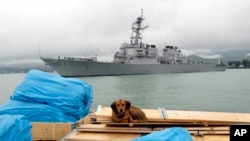FILE - The U.S. guided missile destroyer USS Stout enters Georgia's Black Sea port of Batumi, July 14, 2009. An Iranian boat crossed in front of the Stout three times at high speed Wednesday in the Persian Gulf, U.S. officials said.