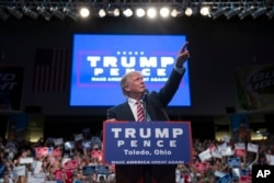 Republican presidential candidate Donald Trump points to the crowd as he speaks during a campaign rally, July 27, 2016, in Toledo, Ohio.