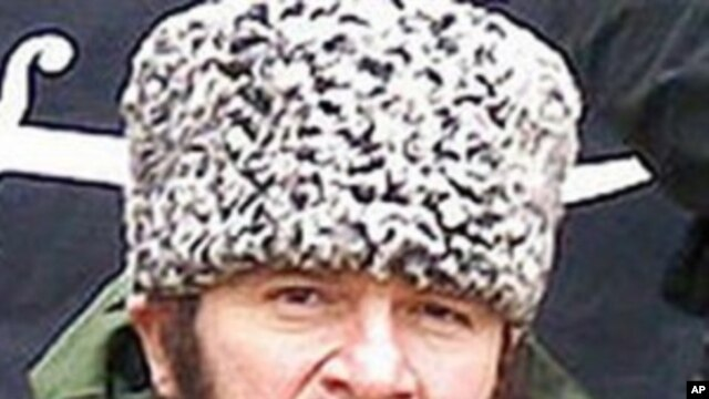 In this screen shot taken in Moscow, Wednesday, Dec. 2, 2009 a computer screen shows an undated photo of a man identified as Chechen separatist leader Doku Umarov posted on the Kavkazcenter.com site.