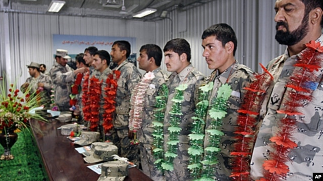 Newly graduated Afghan border police officers stand during a graduation ceremony at the border police headquarter in Jalalabad, Afghanistan, January 31, 2012.