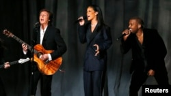"""From left, Paul McCartney, Rihanna and Kanye West perform """"FourFiveSeconds"""" at the 57th annual Grammy Awards in Los Angeles, California, Feb. 8, 2015."""