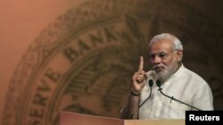 FILE - India's Prime Minister Narendra Modi speaks during an event on financial inclusion in Mumbai, April 2, 2015.