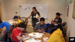 Tribal youth from across the Northwest work on comic book panels on another track of the recent health promotion conference.