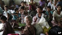 Local residents take refuge in a monastery compound in Sittwe, the capital of Rakhine state in western Myanmar, where sectarian violence continues to impact the public, Wednesday, June 13, 2012. Heavy rain Wednesday brought an uneasy calm to western Myanm