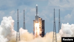 The Long March 5 Y-4 rocket, carrying an unmanned Mars probe of the Tianwen-1 mission, takes off from Wenchang Space Launch Center in Wenchang, Hainan Province, China July 23, 2020.