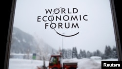A logo is pictured on a window ahead of the World Economic Forum (WEF) annual meeting in the Swiss Alps resort of Davos, Switzerland, Jan. 21, 2018