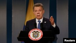 FILE - Colombia's President Juan Manuel Santos talks during a news conference after a meeting with former Colombian President Alvaro Uribe at Narino Palace in Bogota, Colombia, Oct. 5, 2016.