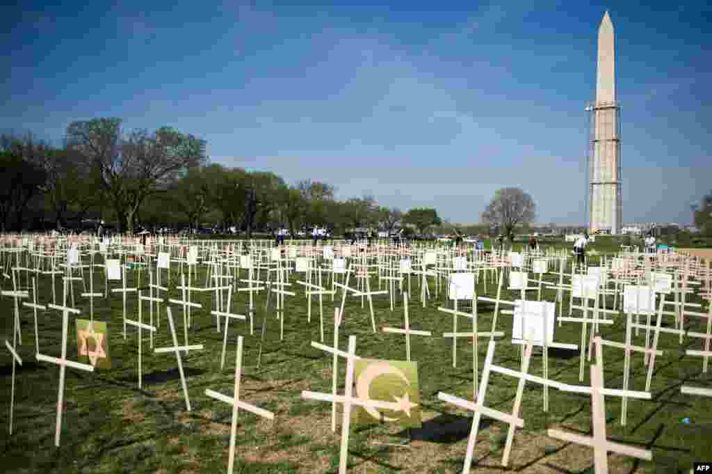Hundreds of crosses, representing gun deaths since the Newtown, Connecticut elementary shootings, are placed on the National Mall in Washington, D.C. Two U.S. senators have reached a compromise that would expand background checks for gun sales in what could result in the most ambitious change to gun laws since 1994, an official said.