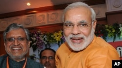 Chief Minister of India's western state of Gujarat Narendra Modi, right, stands with Bihar state Deputy Chief Minister Sushil Modi, June 9, 2013.