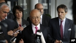 Director General of the International Atomic Energy Agency, IAEA, Yukiya Amano, center, speaks to the media after returning from Iran at the Vienna International Airport, Austria, May 22, 2012.
