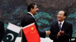 巴基斯坦總理吉拉尼(左)與中國總理溫家寶(右)雙方都表示讚揚的這次會談