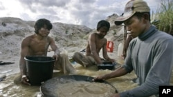 Traditional miners pan for gold at a mine in Hampalit, Central Kalimantan, Indonesia.